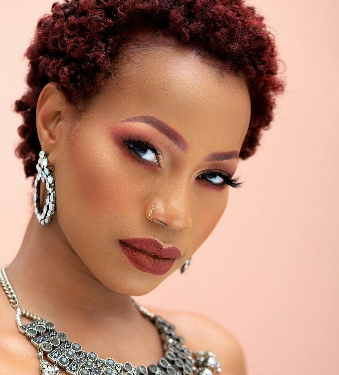Sheebah Karungi with a trendy short perm rod hairstyle on her natural hair