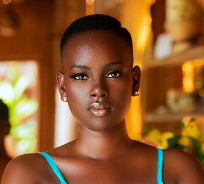 Bettinah Tianah prefers her natural haircut with a line. her signature look.